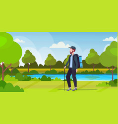 man tourist hiker with backpack holding stick vector image