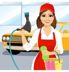 Smiling young girl washing a car vector image