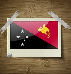 Flags Papua New Guinea at frame on wooden texture vector image