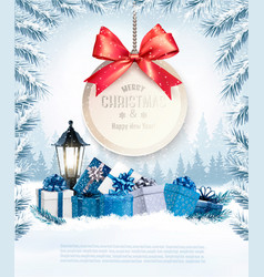 Christmas presents with a gift card and a gift vector