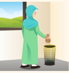 Muslim woman throwing away trash vector