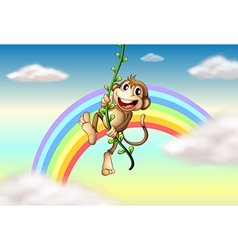 A monkey hanging on a vine plant near the rainbow vector image