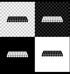 Striped awning icon isolated on black white and vector