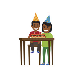 boy and girl at table with happy birthday cake vector image