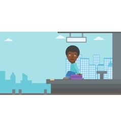 Man sitting on suitcase at the train station vector