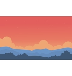 Silhouette of hill and orange sky vector image vector image