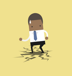 African businessman standing on cracking floor vector