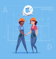two mix race female builders shaking hands vector image