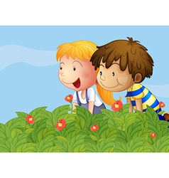A boy and a girl in the garden vector image