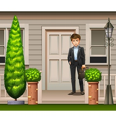 A man in front of their house vector
