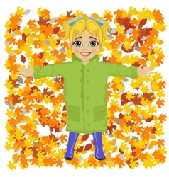 Cute little girl lying on colorful autumn leaves vector