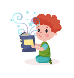 cute little redhead boy reading fairytale book vector image
