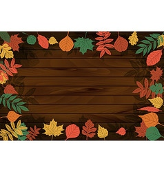 autumn leaves on the background wood vector image