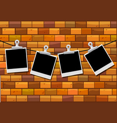 Photo frames hanging on brick wall vector