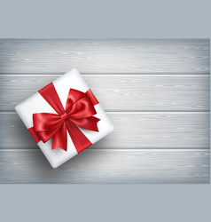present gift box with bow on wooden vector image