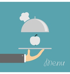 Hand holding silver platter cloche with chefs hat vector