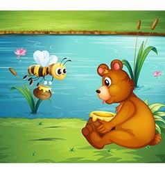 A bear and a bee at the riverbank vector image