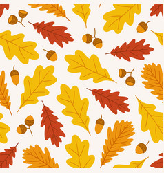 Autumn seamless pattern with acorns and oak leaves vector