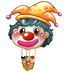 A big clown balloon with kids in the big basket vector image
