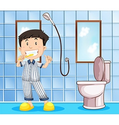 Boy brushing teeth in the bathroom vector image