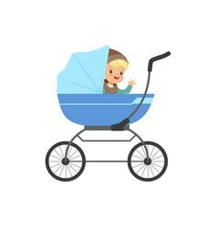 cute little boy sitting in a blue baby pram vector image