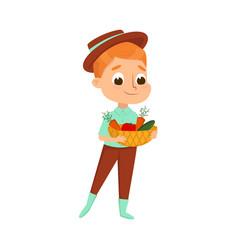 cute boy holding basket fresh ripe vegetables vector image