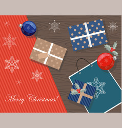 christmas presents on a table top view vector image