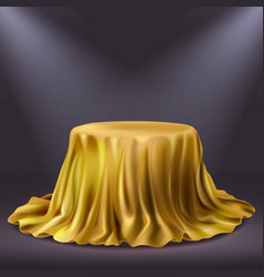 Round show table stage covered with golden cloth vector