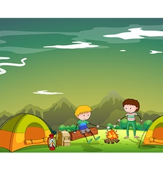 Two men camping out on the mountain vector image vector image