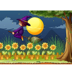 A witch in the garden vector image vector image