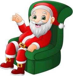 Cartoon santa claus sitting on green sofa vector