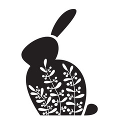 Silhouette an easter bunny with white flowers vector