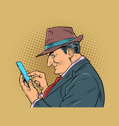 an elderly businessman with a smartphone the boss vector image