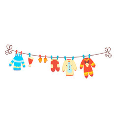 Various items baby clothes on rope isolated vector