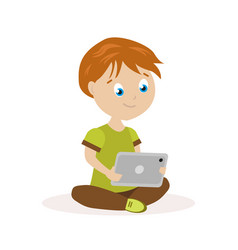 Boy sitting on the floor with a tablet in hands vector