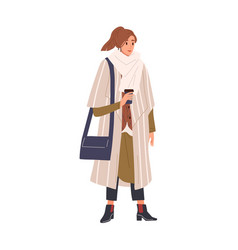 Woman in classy winter outfit holding paper coffee vector