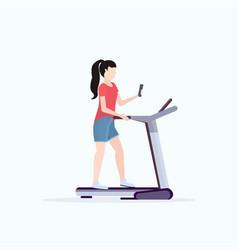 woman running on treadmill girl using smartphone vector image