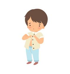 Little boy dressing up himself vector