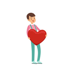 Happy teen boy holding red heart happy valentines vector