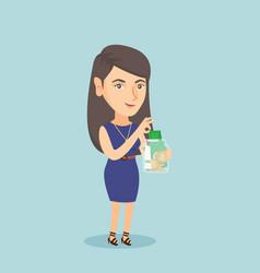 Caucasian woman putting dollar into a glass jar vector