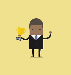 african businessman holding winning trophy vector image