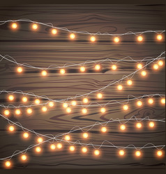 christmas garlands isolated on wooden background vector image
