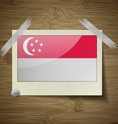 Flags Singapore at frame on wooden texture vector