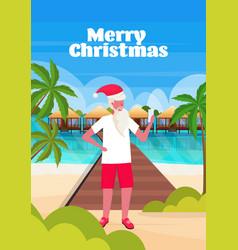 man wearing santa claus hat using smartphone vector image