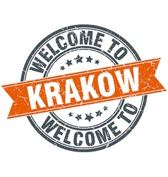 Welcome to Krakow orange round ribbon stamp vector