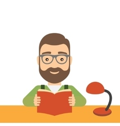 Man reads a book while sitting at the table vector
