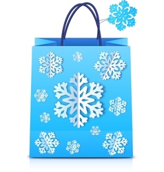 Blue Christmas shopping bag with paper snowflakes vector