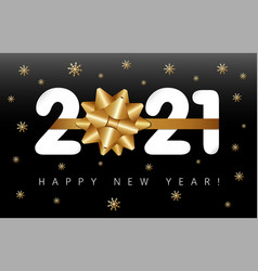 2021 paper and golden bow on black vector image