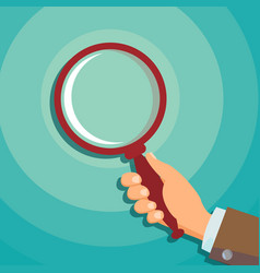 Hand holding magnifying glass data vector