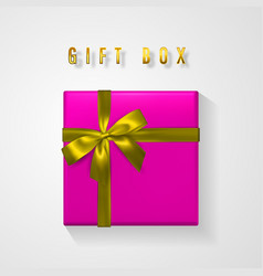 pink gift box with golden bow and ribbon top view vector image